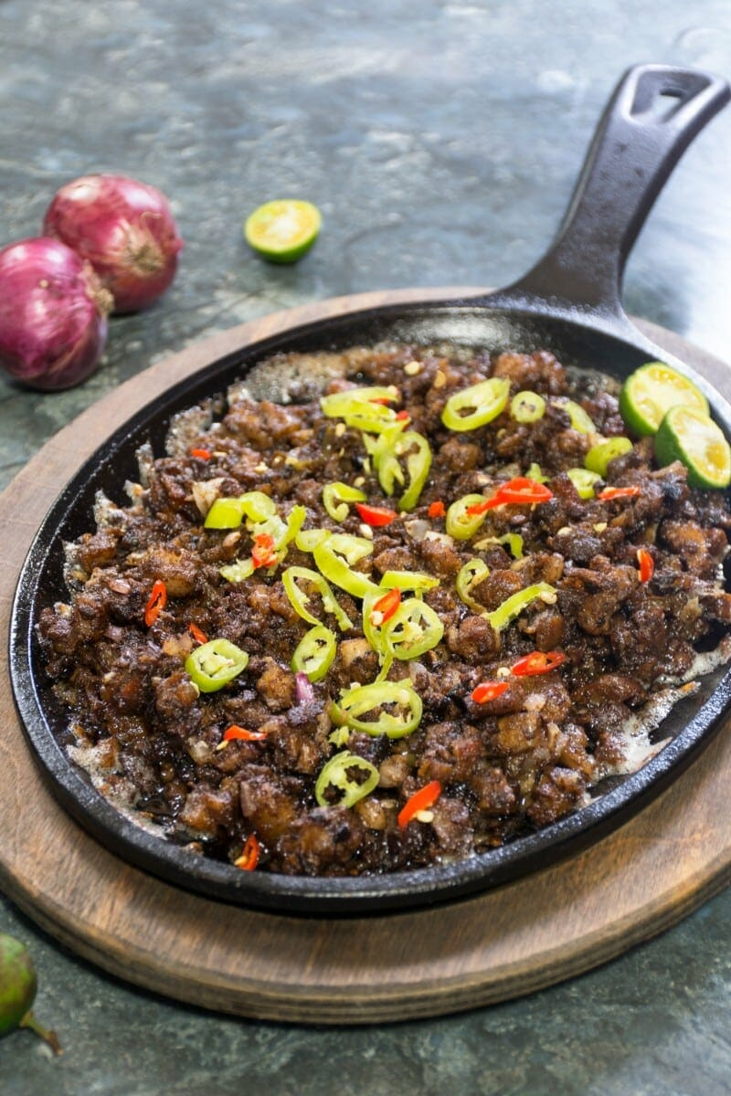 Sizzling Pork On Pan With Onions